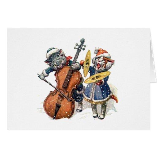 Gatos que jogam a música do Natal na neve Cartao