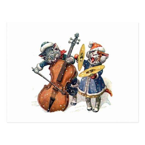 Gatos que jogam a música do Natal na neve Cartoes Postais