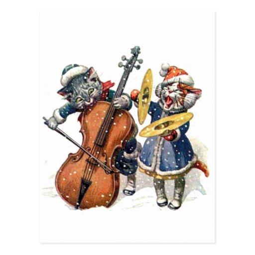 Gatos que jogam a música do Natal na neve Cartao Postal