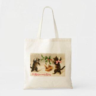 Gatos que jogam no bolsa do natal vintage da neve