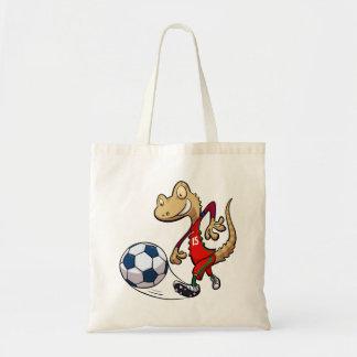 Geco feliz da estrela de futebol que retrocede sacola tote budget