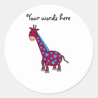 Girafa azul e cor-de-rosa adesivo em formato redondo