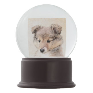 Globo De Neve Filhote de cachorro do Sheepdog de Shetland que