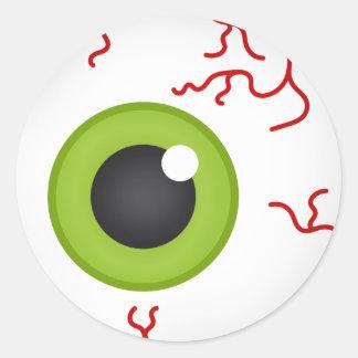 Globo ocular verde etiqueta deslocada disparada