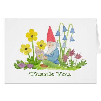 Gnomo com os cartões de agradecimentos do livro da