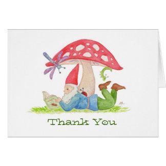 Gnomo com os cartões de agradecimentos do livro do