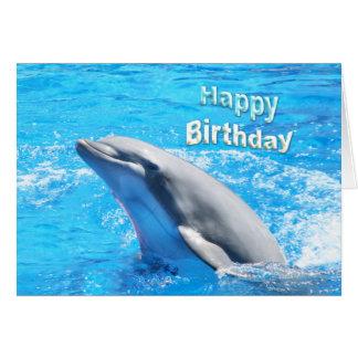 Golfinho no cartão do feliz aniversario da água