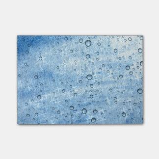 Gotas da água azul bloco de notas