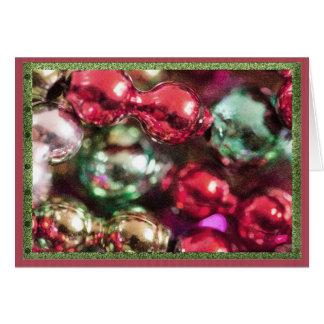Grânulos coloridos do Natal Cartão