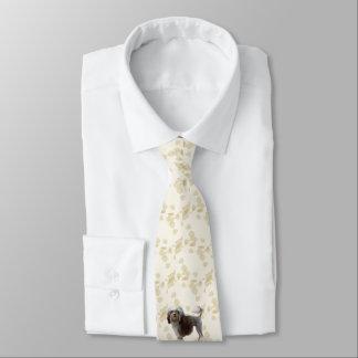 Gravata Lowchen em Tan deixa a impressão em ambos os lados