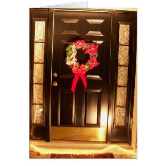 Grinalda do Feliz Natal no cartão da porta da rua