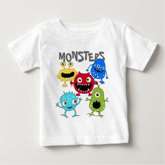 Grupo bonito de camisas infantis dos monstro T