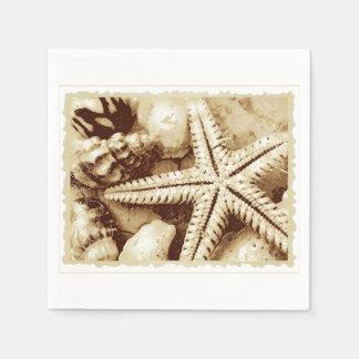 Guardanapo de papel da estrela do mar e dos