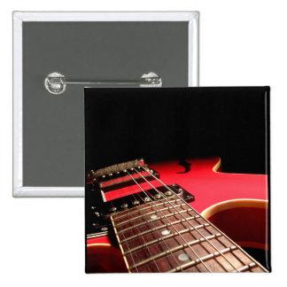 Guitarra elétrica vermelha pins