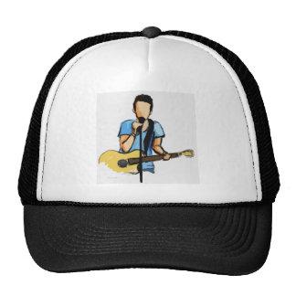 Homem de canto com esboço da guitarra boné