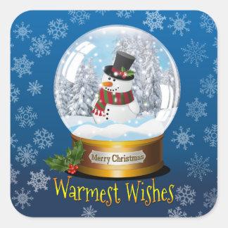 Homem quadrado da neve em uma etiqueta do globo da
