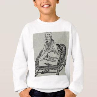 Homem que senta-se na pose da meditação agasalho