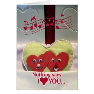 Humor do aniversário - dois corações na cama cartoes
