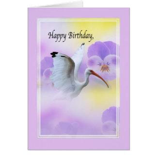 Íbis com o cartão de aniversário das flores
