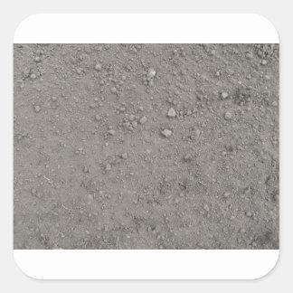 Ideia de ângulo alto da terra marrom adesivo quadrado
