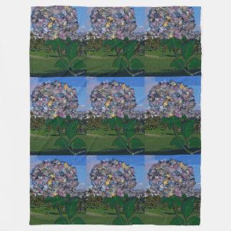 Ilusão óptica:  Uma flor cresce no parque de Cobertor De Lã