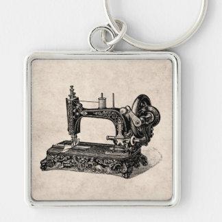 Ilustração da máquina de costura dos 1800s do vint chaveiros