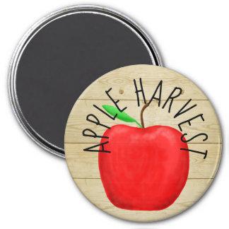 Imã Apple vermelho colhe o ímã de madeira do sinal