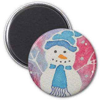Imã boneco de neve em um chapéu lanoso