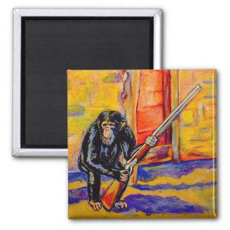 Imã Chimpanzé com um ímã da arma