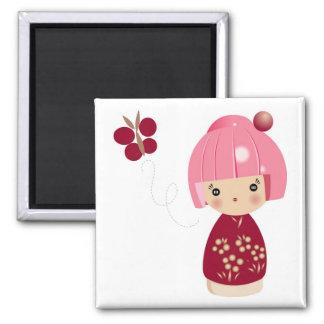 Ímã cor-de-rosa da objectiva tripla de Kokeshi Imã