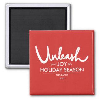 Imã Desencadeie seu feriado rotulado da alegria   mão