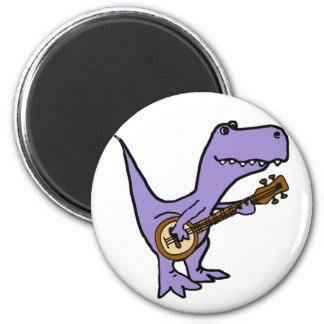 Imã Dinossauro engraçado de T-rex que joga o banjo