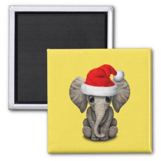 Imã Elefante do bebê que veste um chapéu do papai noel