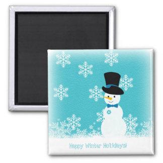 Imã Flocos de neve brancos azuis e boneco de neve