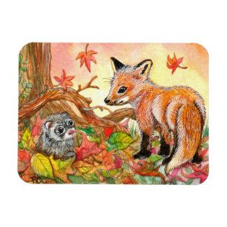 Ímã Fox e doninha nas folhas de outono