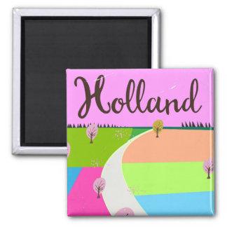Imã Holland coloca o poster de viagens