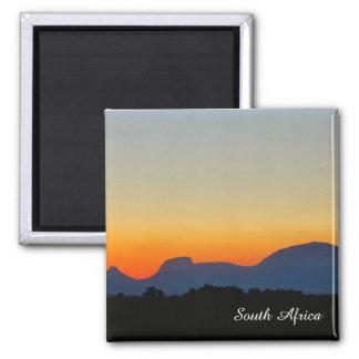 Imã Ímã das montanhas do por do sol de África do Sul