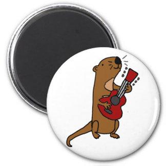 Imã Lontra de mar engraçada que joga a guitarra