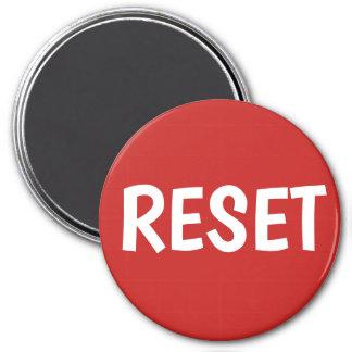Imã Pressione o botão de restauração