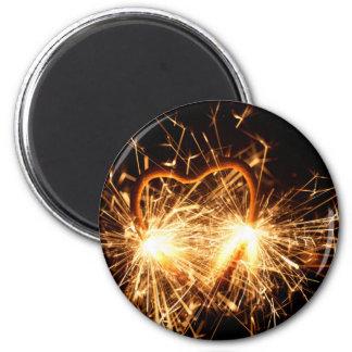 Imã Sparkler ardente no formulário de um coração