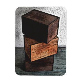 Ímã Três caixas de madeira no armário