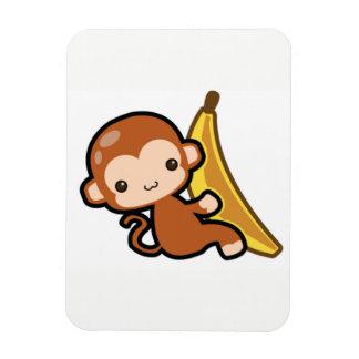 Ímã Whit bonito do macaco do bebê uma banana