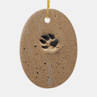Impressão animal da pata na areia ornamento de cerâmica