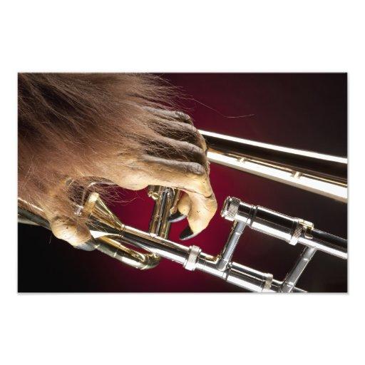 Impressão da mão do monstro do Trombone do Dia das Fotografia