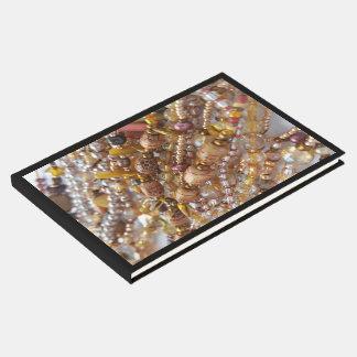 Impressão da miçanga dos tons da terra do livro de