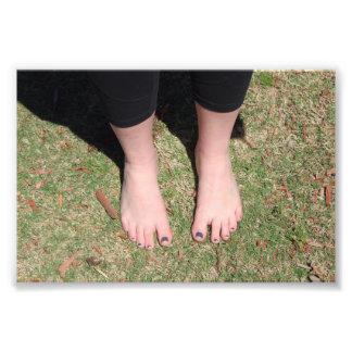 Impressão descalço da foto do ar livre
