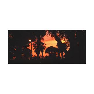 Impressão Em Canvas As palmeiras mostram em silhueta no por do sol