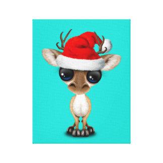 Impressão Em Canvas Cervos do bebê que vestem um chapéu do papai noel