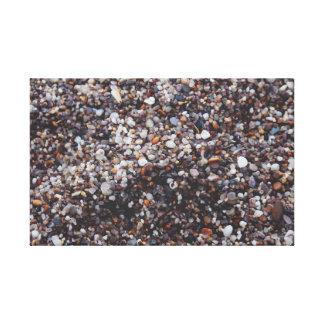 Impressão Em Tela Seixos coloridos em uma praia