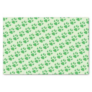 Impressões verdes da pata papel de seda